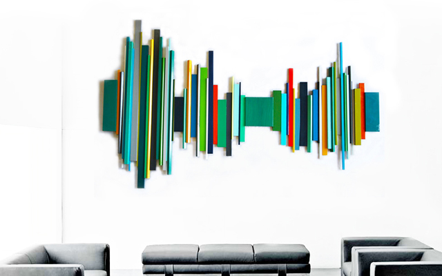 A colorful mid-century-modern wall sculpture