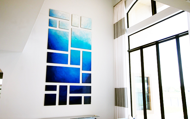 Large abstract painting across panels of various shapes and sizes