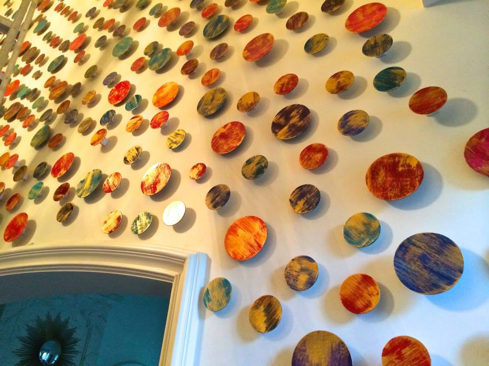 A large art installation made of painted wood circles