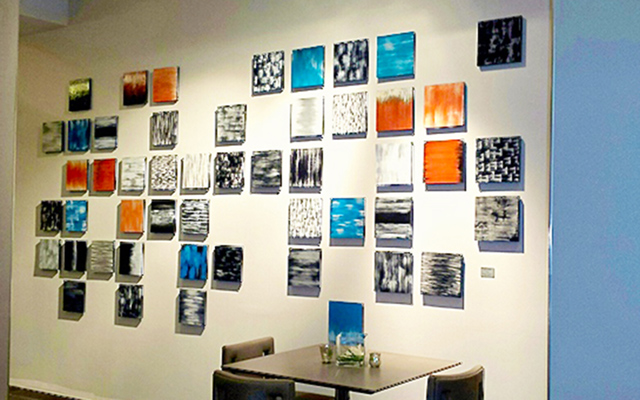 Geometric, abstract paintings hanging in a hotel restaurant