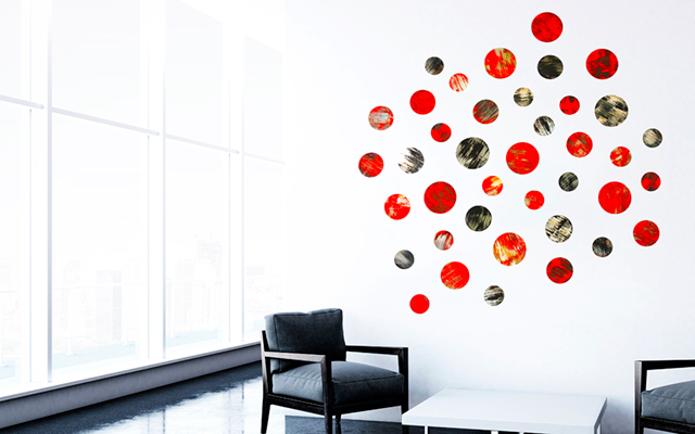 Collection of red wall art, on white wall