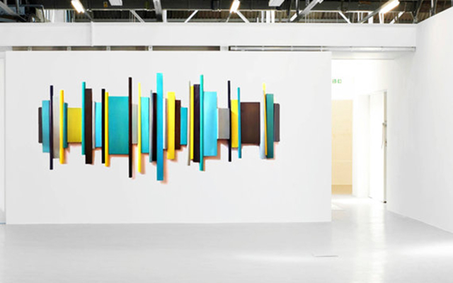 Large 3-dimensional wall sculpture, painted in blues and yellow