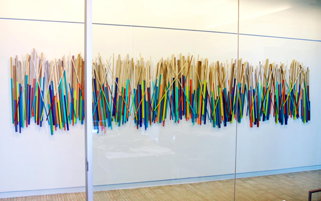 Wood stick wall sculpture in a corporate office space