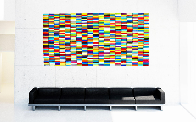 Rolls of Color, a vibrantly painted geometric wall sculpture