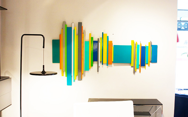 Wall Sculpture created with painted wood pieces of various shapes and sizes