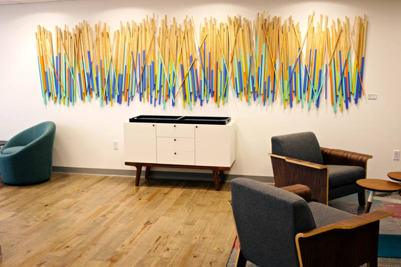 Painted wood stick wall sculpture